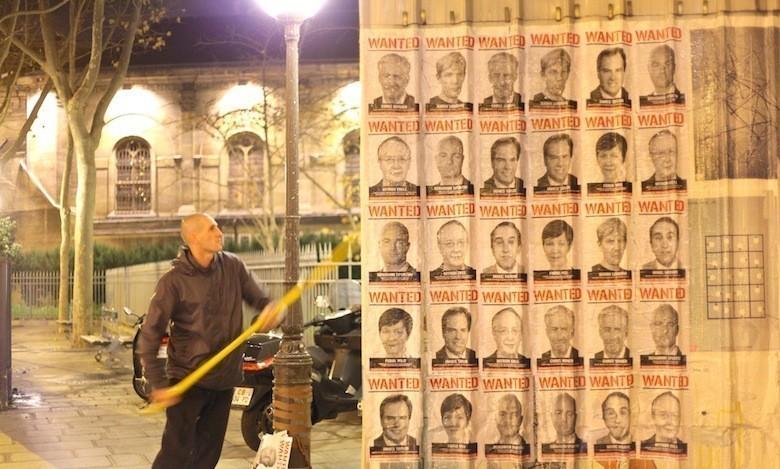 Les visages des lobbyistes «criminels du climat» placardés dans Paris